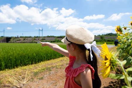 Girl pointing at a distant railroad track