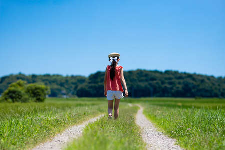 A child walking on a summer road