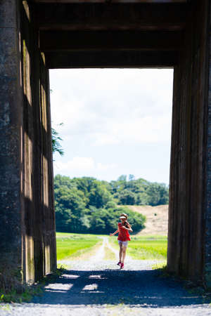 Rural scenery and girl on the other side of the tunnel