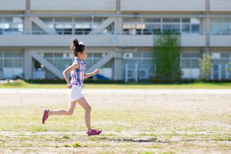 Girl running in the schoolyard