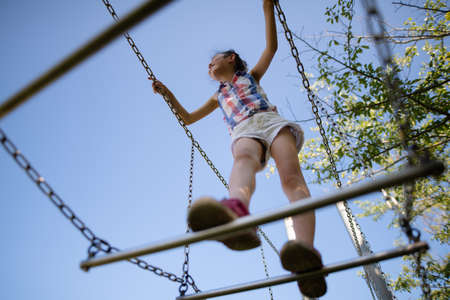 Girl playing with playset in the park