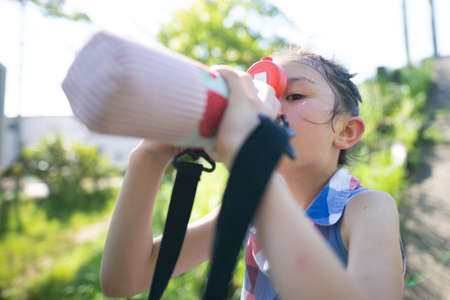 Girl drinking water from a water bottle