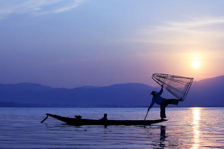 Silhouette of fishermen in Inle Lake