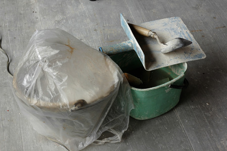 Trowel plaster placed on the floor. Stock Photo