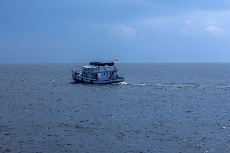 The boat is taking tourists to the sea.