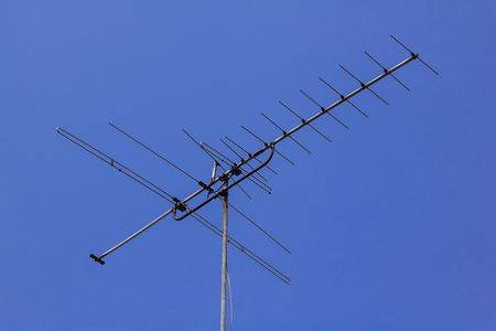 Old TV antenna located at home Stock Photo