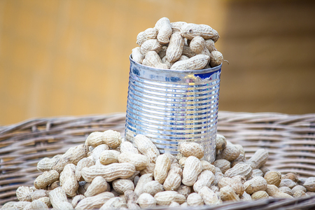 Boiled peanuts in cans Placed on the tray for sale Stock Photo