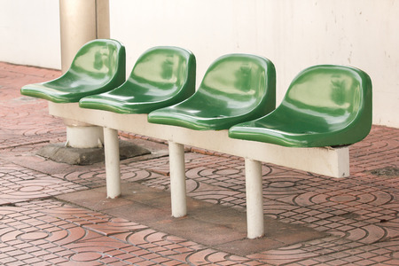 Green plastic chair at the bus stop For passengers waiting