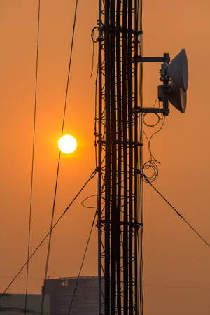 Antenna on a high rise building with sunset time