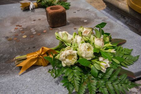 In the Thai temple, lotus flowers are placed on the altar. To show respect Stock Photo