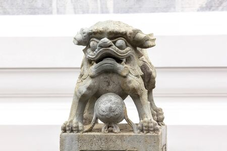 Chinese style lion carved stone on the pedestal is a sacred animal of Chinese belief.