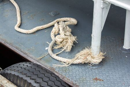 Old rope tied to the ship's steel pole
