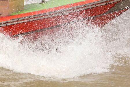 Water splashed from a speed boat in the river 스톡 콘텐츠