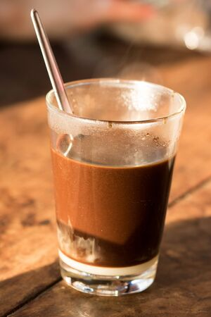 Hot coffee in a glass, put on the table