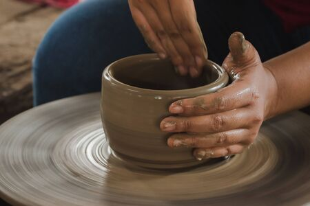 Making pottery by hand to make a container