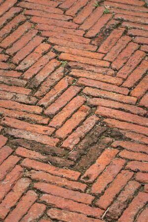 The pedestrian path is made of bricks.