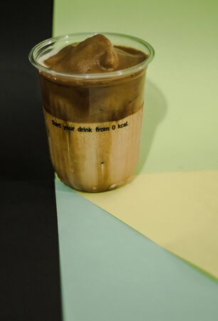 Ice latte coffee in a plastic mug , Coffee cream in a glass Imagens