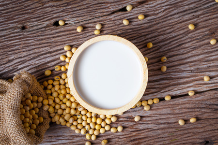 soybean on wooden background and empty space