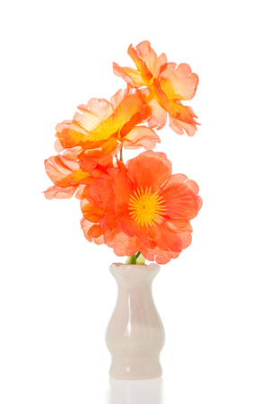 Plastic flower in ceramic vase isolated on white background
