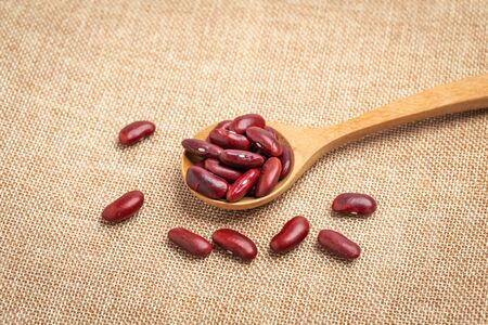 red beans in spoon on sackcloth