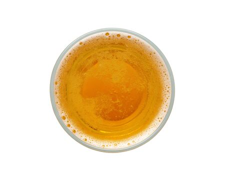 beer bubbles in glass cup on white background. top view.