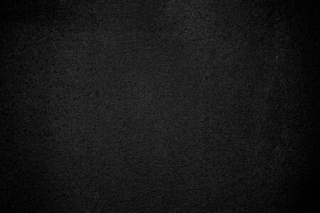 Fondo áspero del modelo de la textura de la pared negra. Antiguo fondo de grunge negro. Espacio de copia de papel tapiz oscuro para el diseño.