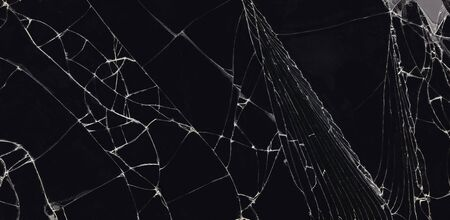 broken glass dark background texture, Cracked touch screen phone. Banco de Imagens