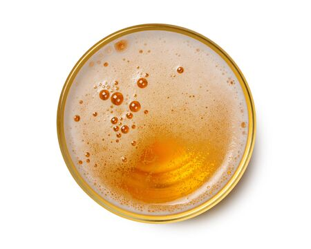 top view of beer bubbles in glass cup on white background.
