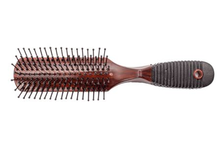 woman hair comb isolated on white background. brown hair brush isolated on white background.