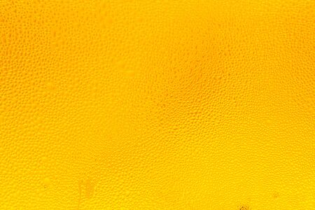 Drops of water on a glass of beer. Droplets on freshly poured beer, Droplets on freshly poured beer background and texture