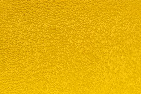 Background of water drops on the surface in golden colors
