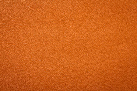 Synthetic leather brown background texture. Brown leather textured background.