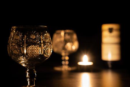 Brandy glass with wine bottle.