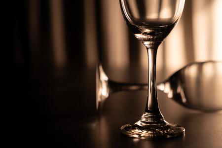 Two wine glasse, one overturn. 版權商用圖片