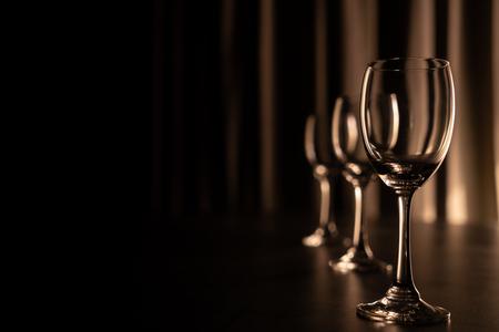 Three empty wine glasses.