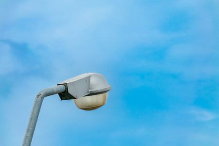 Street lamp on blue sky background.