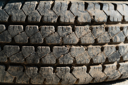 The old used tire with abrasion tread.
