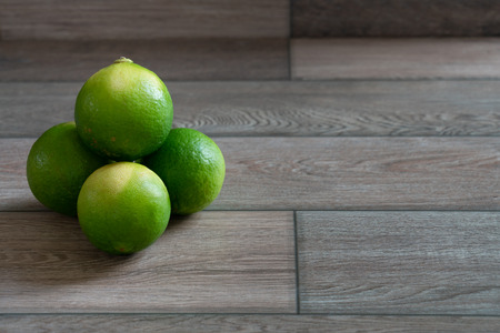 Group of limes on the wood table. Stock Photo - 116986828