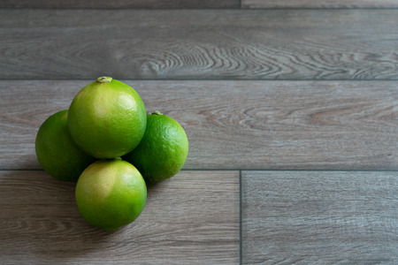 Group of limes on the wood table. Stock Photo - 116986856