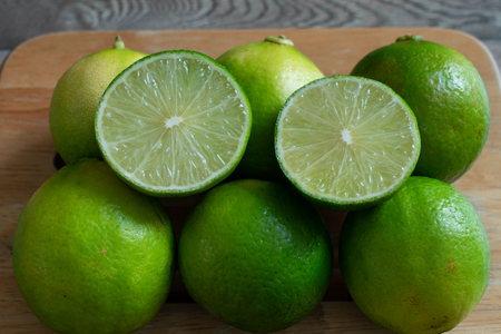 Fresh lime on the wooden tray. Stock Photo - 116986866