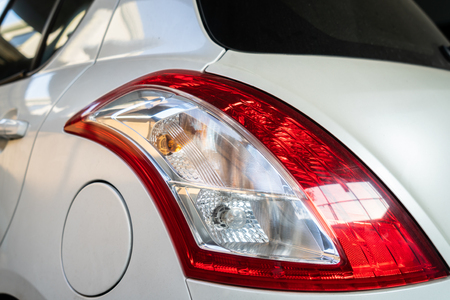 Photo of car tail lamp and fuel tank cover. Stock Photo