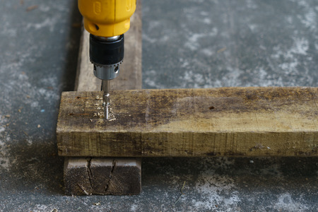 Driller, wood and screw for carpenter's job