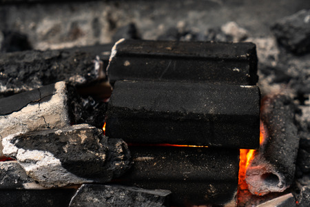 The burning charcoal in the charcoal grill stove