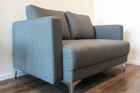 A grey sofa bed at the room corner