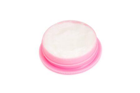 Pink plastic cream jar isolated on white background