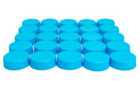 Blue plastic cream jars isolated on white background