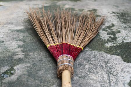 Photo of the broom on cement ground Stock Photo