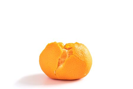 A peeled Amorette mandarin orange isolated on the white background