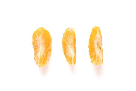 Three segments of Amorette mandarin orange isolated on the white background