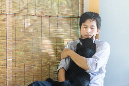 The love between a black cat and the owner. Stock Photo